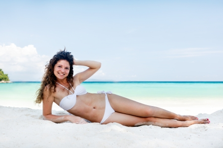 Portrait of a happy young woman posing while on the beach Stock Photo - 17924986