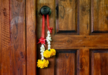 welcome door: Traditional Thai bouquet hanging on wooden door