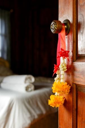 Traditional Thai bouquet hanging on wooden door Stock Photo - 18242249