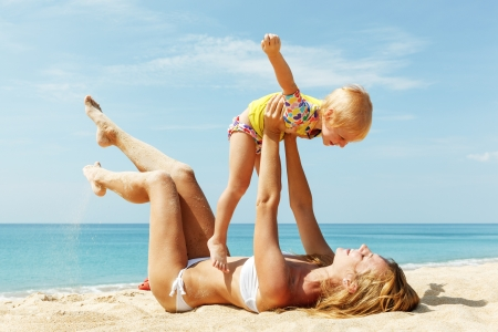Mother With Little Nice Daughter on beach photo