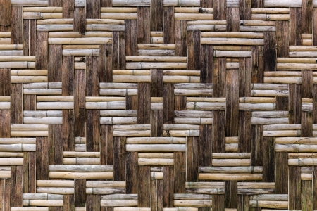 trellis: Straw and wooden fence with a beautiful ornament - outdoor