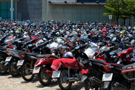 Many motorbikes at the parking near big store