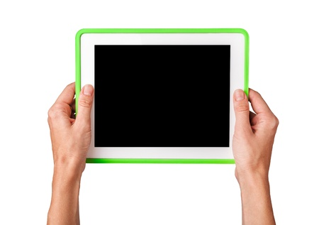 Female hands holding a tablet touch computer gadget photo