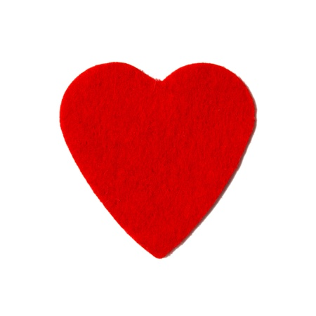 Small felt red heart isolated on a white background photo
