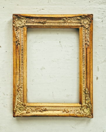 antique frame: Golden old frame on the grunge background