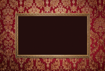 burgundy background: Red retro interior with empty exposition in gold frame and wall