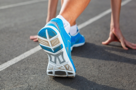 Runner Feet Running on Stadium Closeup -outdoor shot Stock Photo