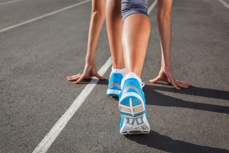 Runner Feet Running on Stadium Closeup -outdoor shot Stock Photo