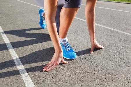 Runner Feet Running on Stadium Closeup -outdoor shot photo