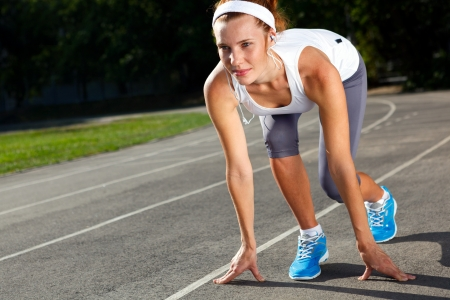 Woman getting ready to start on Stadium - summer outdoors training  photo