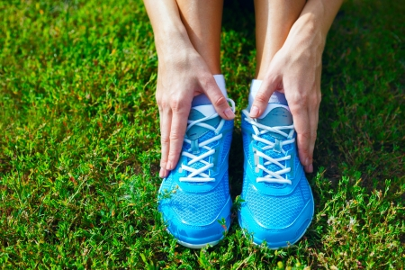 Closeup of running shoes on grass - concept image Stock Photo