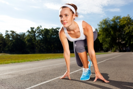 Portrait of Beautiful Woman ready to start running. Stock Photo