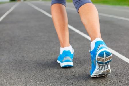 Runner Feet Running on Stadium Closeup - outdoor shot. photo