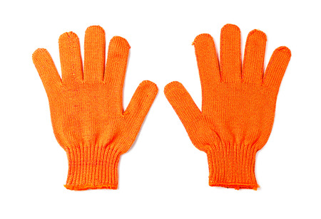 Orange work gloves isolated on white background. photo