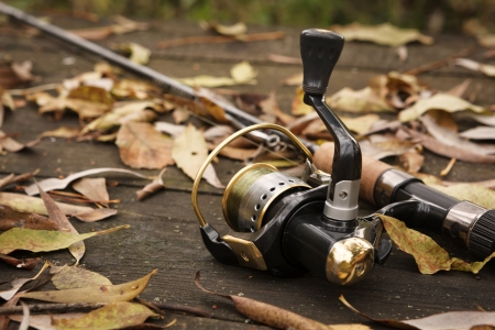 Fishing tackle on wooden weathered surface. photo