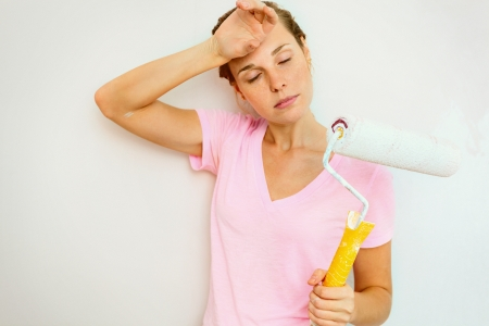 Woman resting painting the wall Stock Photo - 24232702