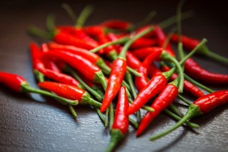 thai pepper: Hot Thai Red Chili Peppers on table Stock Photo