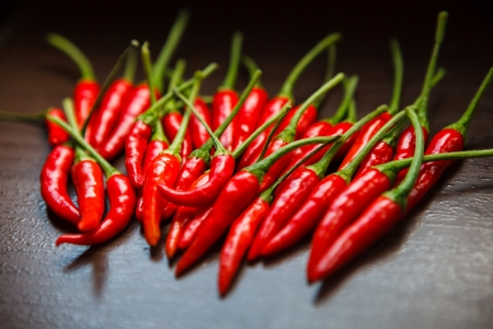 red chilli: Hot Thai Red Chili Peppers on table Stock Photo