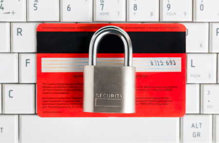 Credit Card and padlock on keyboard - security, e-commerce concept. photo