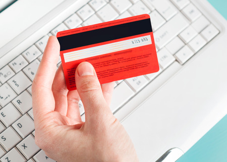 e card: Woman holding a credit card for online shopping  Stock Photo