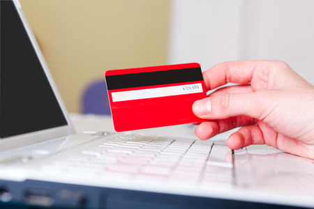 pay bill: Woman holding a credit card for online shopping  Stock Photo