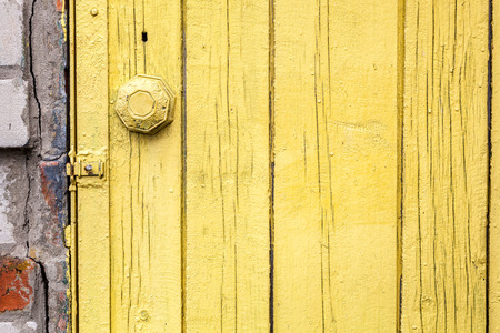 Old weathered door with knob. photo