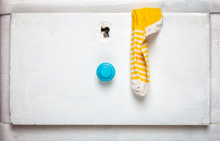 slovenly: Socks stick out from drawer - slovenly person concept.