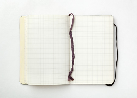 Open notebook on white background. photo