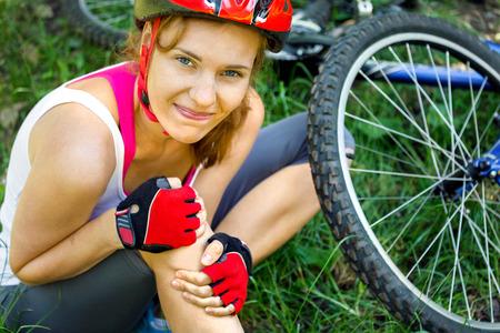 Young woman fell off mountain bike.