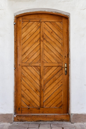 view of a wooden doorway: Old brown wooden door.
