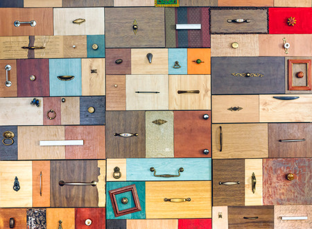 jumble: Various little colorful drawers - interior element Stock Photo