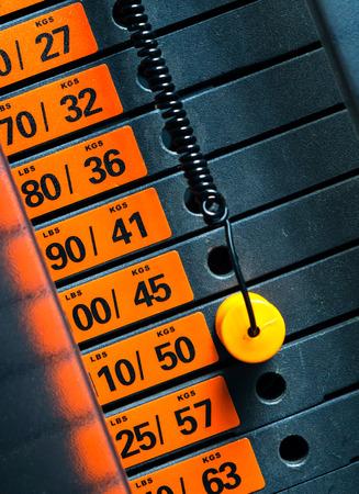 weight machine: Closeup of weight stack with orange pin. Stock Photo