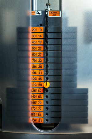 apparatus: Closeup of weight stack with orange pin. Stock Photo