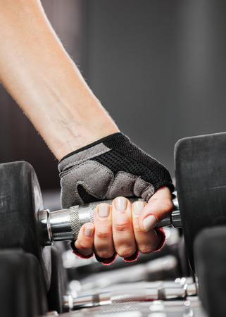 heavy weight: A rack with metal dumbbells in gym.