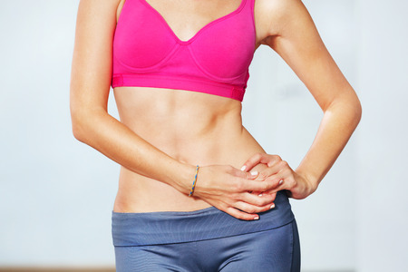 sixpack: Closeup of young slim woman with six-pack torso. Stock Photo
