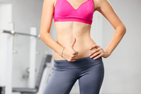 six girls: Closeup of young slim woman with six-pack torso. Stock Photo