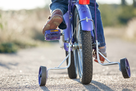 back training: Kids bike with training wheels closeup Stock Photo