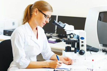 laboratory technician: Beautiful woman in a laboratory working with samples. Stock Photo