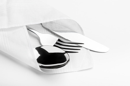 serviette: Knife, Fork, Spoon isolated on white background. Stock Photo
