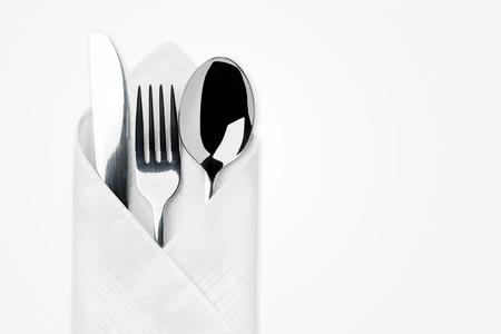 白い背景で隔離のナイフ、フォーク、スプーン。 写真素材