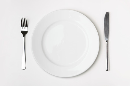 empty plate: Knife, Fork and plate on table isolated.