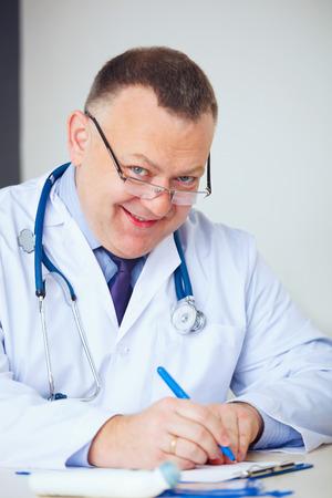funny doctor: Portrait of funny doctor prescribing drugs.