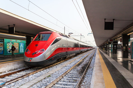fast train: NAPLES, ITALY - NOVEMBER 30, 2014: Napoli Centrale railway station. Freccia Rossa bullet train 300 kmh.