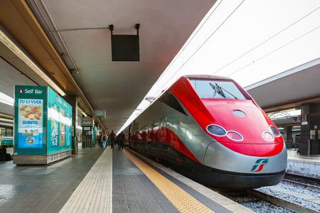 NAPLES, ITALY - NOVEMBER 30, 2014: Napoli Centrale railway station. Freccia Rossa bullet train 300 kmh.
