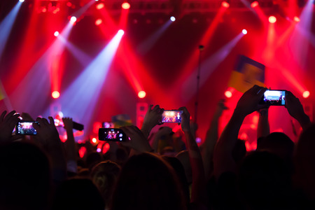 concert crowd: People at concert shooting video or photo. Stock Photo