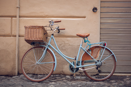 Blue vintage city bicycle with basket. Stok Fotoğraf - 36675424