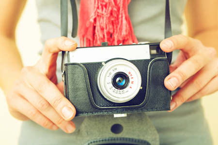 vintage woman: Woman photographer with old lomo camera.