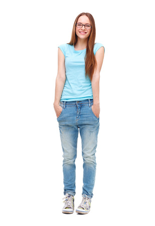 Full length portrait of young girl in casual clothing isolated on white background. photo