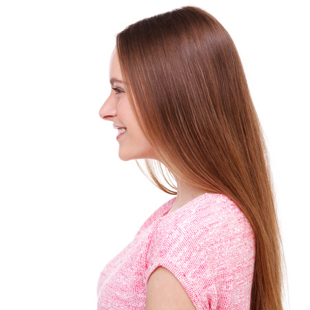side pose: Profile of beautiful young woman isolated on white background.