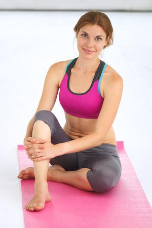 indoors: Young beautiful woman doing yoga indoors.